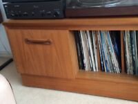 Solid teak retro stereo unit with cupboard and upright shelving for LPs