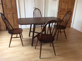 Solid wood drop leaf ercol table and 4 chairs.