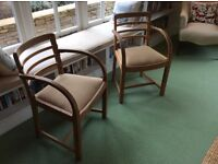 Original pair of 1950's oak Heal's chairs. Perfect for daily or occasional use. New seat upholstery.