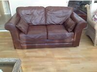Two seater leather sofa, in good conditions