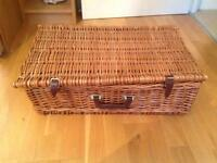 Traditional wicker picnic basket and 4 place settings