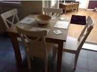 Solid pine table and four white idea chairs
