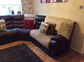 Brown corner sofa with two recliners