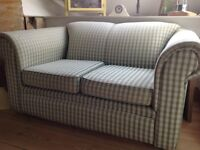 Green check sofa