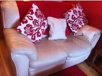 Two cream leather sofas one two seater and one three seater with recliners