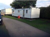 2 bedroom static caravan for sale sited on 12 month Liskey Hill Caravan Park / 10 Minutes to beach