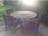 Patio table and 6 carver chairs with cushions