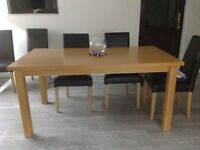 Lovely wooden dinning table excellent condition 190cmx140cm excluding chairs buyer collects