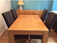 Oak dining set comprising table 6 leather chairs sideboard and mirror