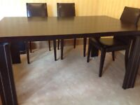 Solid wooden dining table & 6 leather chairs with matching brown leather mirror