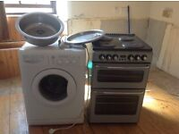 Newhouse electric cooker, Indesit wachine machine, sinks and chrome tap.