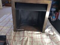 FREE gas fire with coals, and metal surround to fit into fire place. Brass surround needs cleaning.