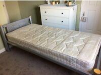Metal framed single bed