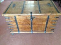 One antique wooden chest with wrought iron handles, clasp and strengthening bars.