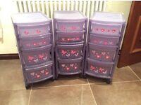 Purple four drawer storage units