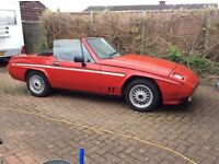 1300cc Scimitar. Red