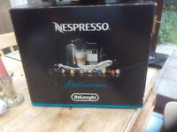 Nespresso e520 Coffee Machine with Milk Frother and pods
