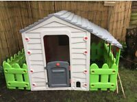 Playhouse with fencing and window box