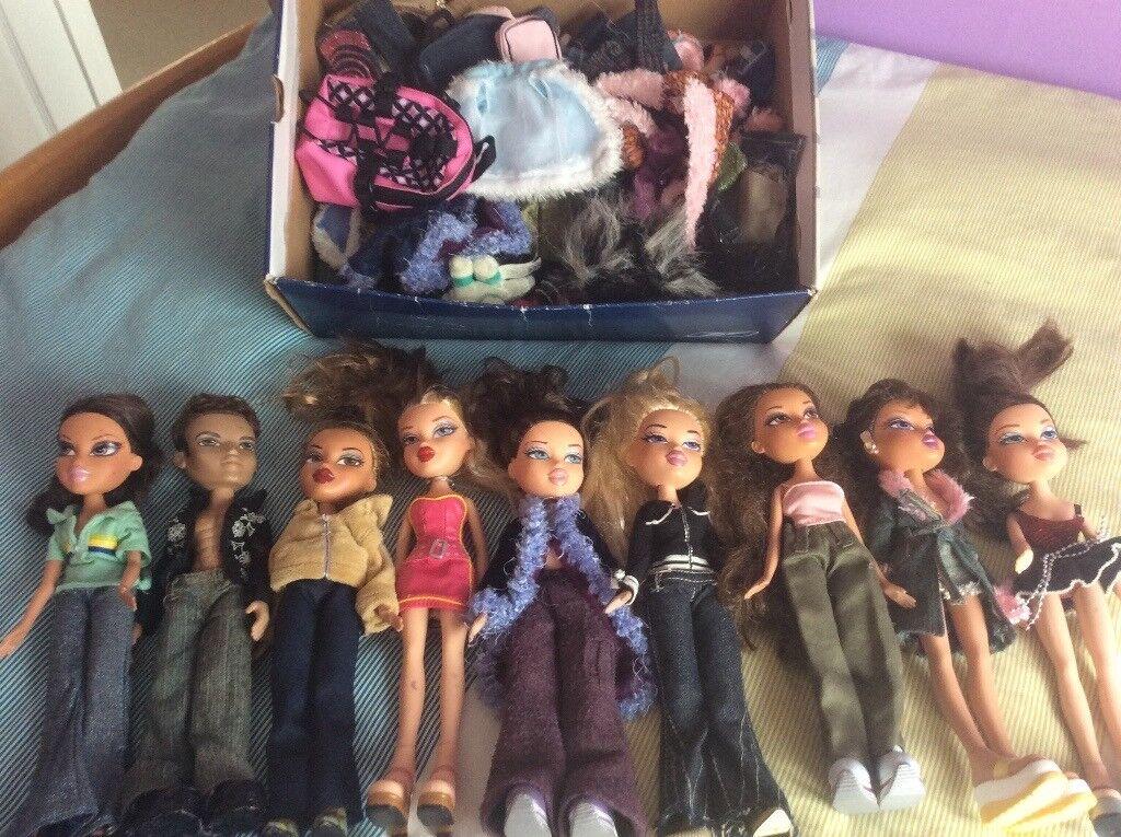 9 Bratz dolls & a box of accessories