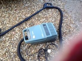 Vintage Hoover,picks up well,has brush for hard floors,requires bags,long hose,