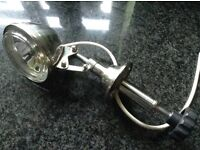 Economy controlled searchlight for a cabin cruiser