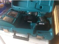 Makita hp 453 li ion drill. Two new batteries Charger and carry case