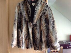 Faux fur coat size 16