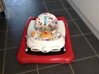 Baby walker for sale, folds flat with removable toy tray. Very good condition.