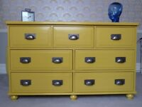 Solid wood painted mustard yellow merchants chest of seven drawers