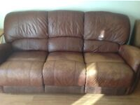 TAN LEATHER RECLINING SETTEES, A THREE AND A TWO SEATER