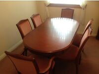 Dinning room table and 6 chairs .