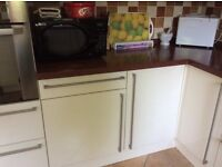 Cream gloss kitchen units to include two full swing corner pull outs