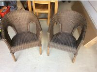 Dark brown wicker chairs x2