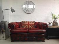 2 seater oxblood Chesterfield sofa. Can deliver