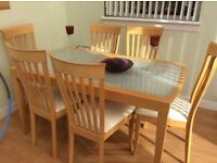 Solid glass/wood dining table and chairs in immaculate condition