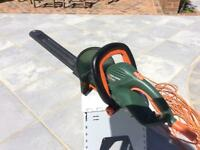 Black & Decker electric hedge trimmer.