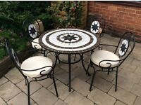Patio table and 4 chairs.