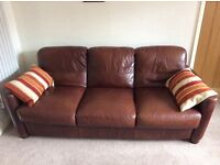 Two leather 3-seater sofas.