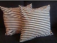 Two black and white Ikea cushions