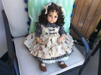 Porcelain/ china doll,£40. this a beautiful doll of excellent quality.
