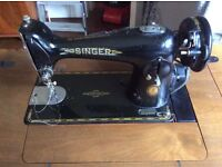 Singer Sewing Machine - vintage model 60 years old. In a walnut cabinet.