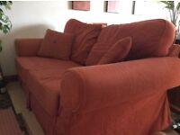 Sofa bed, terracota colour.