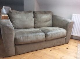 Two seater moss green sofa