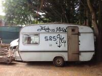 Small caravan, spares, repairs, scrap, squalid little love nest?