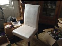 A pair of White dining or bedroom chairs
