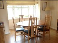 Ercol light wood oval dining table and 6 chairs(not Ercol)