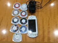 PSP with 7 games with 2 DVDs