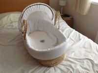 Moses basket with polyester white cotton lining in very good condition