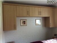 Overhead bedroom unit with standing drawer units