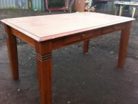 Rustic stained pine dining table with double cutlery drawers